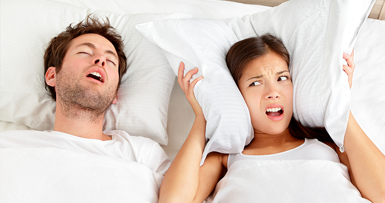 Couple in bed where women is annoyed of the snoring